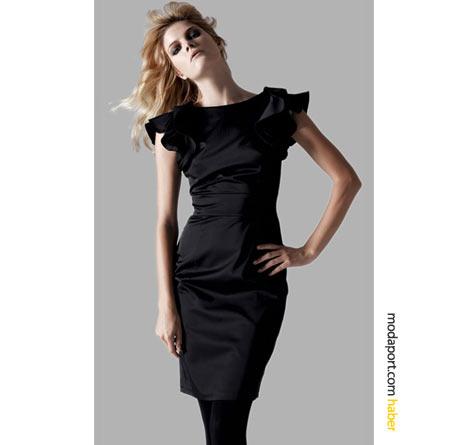 Bu mini siyah gece elbisesi, kollarıyla hareket kazanmış