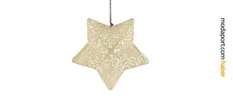 Beyaz reçineden Noel yıldızı, rölyef desenlerle süslenmiş