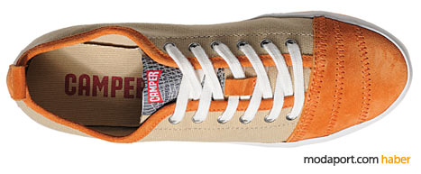 Camper'ın turuncu süetle detaylandırılmış renkli spor ayakkabılarından biri