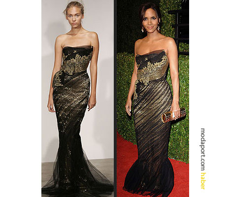 Oscar Ödülü Halle Berry, vücudu saran, siyah ve altın renkli gece elbisesi ile. Marchesa elbise Marchesa'nın sonbahar koleksiyonundan.