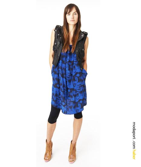 2010'un genç giyim stillerinde yeri vazgeçilmez olan tayt, DKNY'nin bu kombinasyonunda elbise, yelek ve topuklu ayakkabılarla..